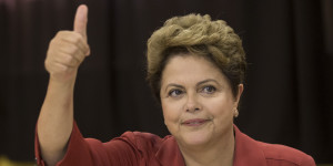 Brazil's President Dilma Rousseff, presidential candidate for re-election of the Workers Party (PT), gestures after voting during Brazil's presidential election runoff in Porto Alegre, Brazil, Sunday, Oct. 26, 2014. (AP Photo/Felipe Dana)